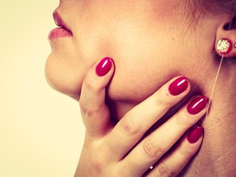 Women checking her thyroid