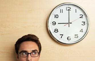Man glancing at clock
