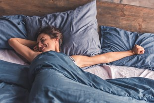 Well-rested woman waking up in the morning