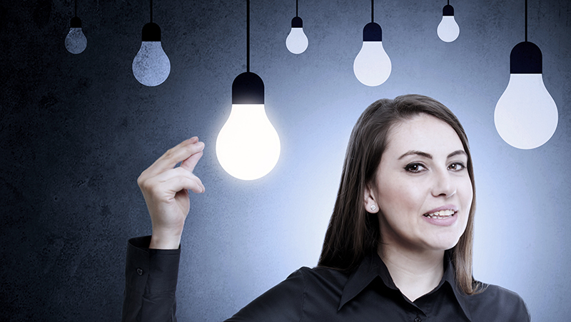 Woman surrounded by lightbulbs