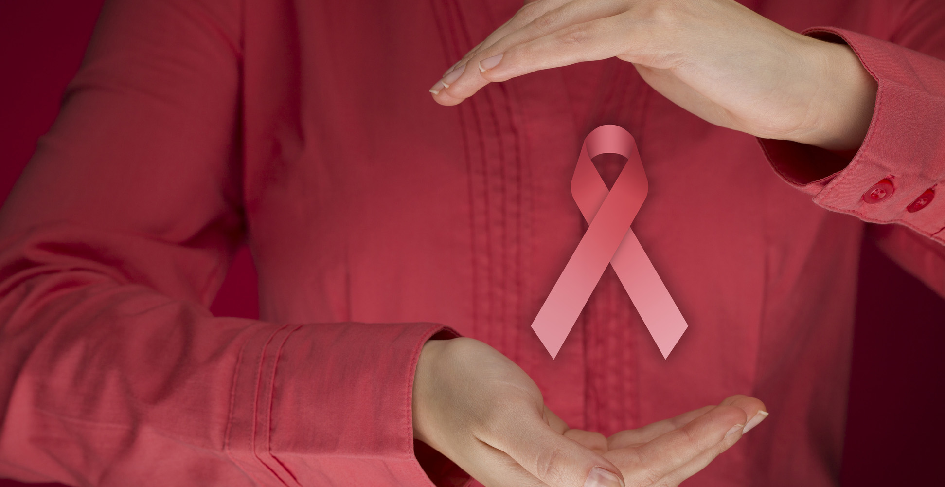 Woman with breast cancer prevention ribbon