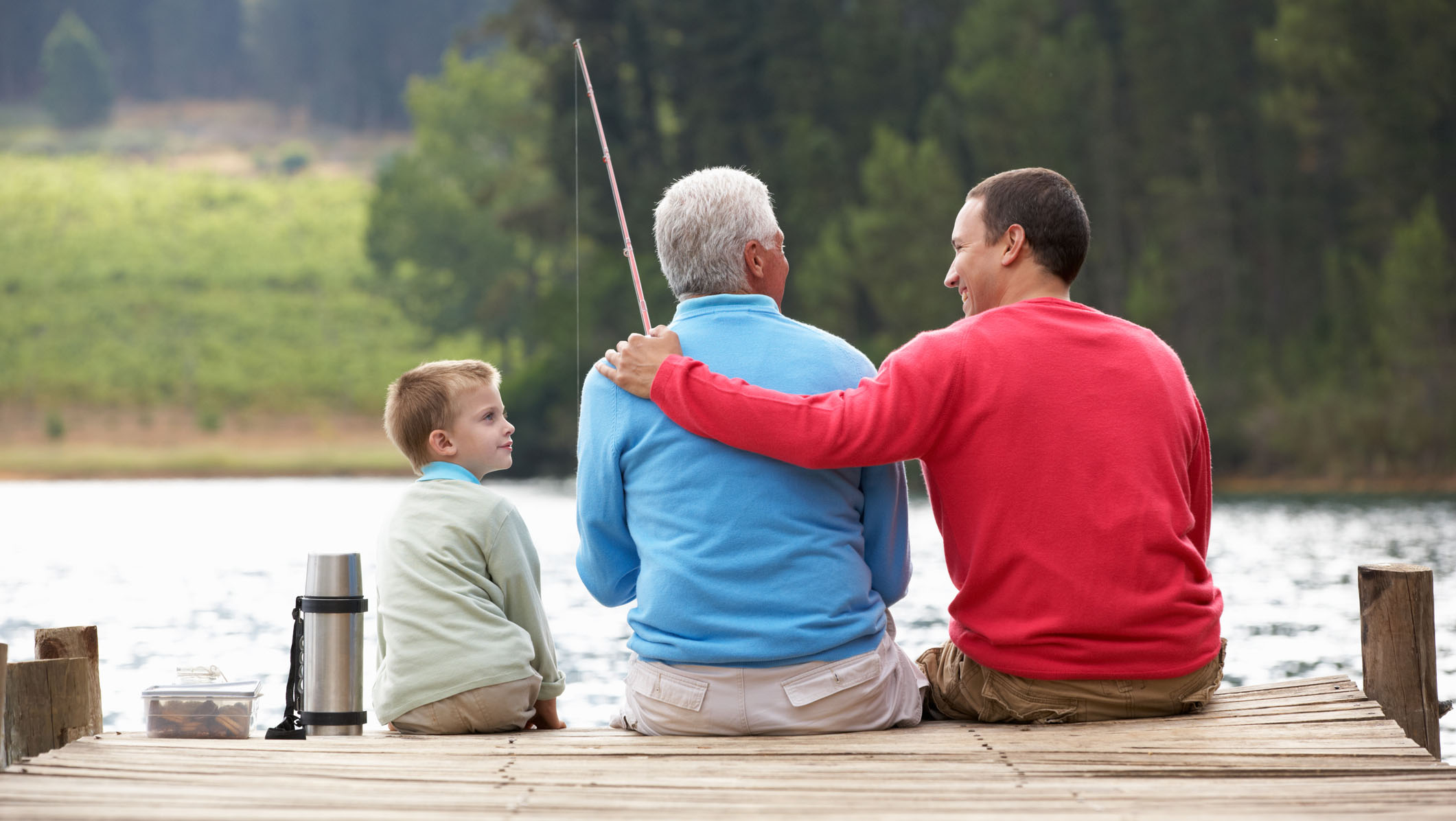Grandfather, father, and son fishing together