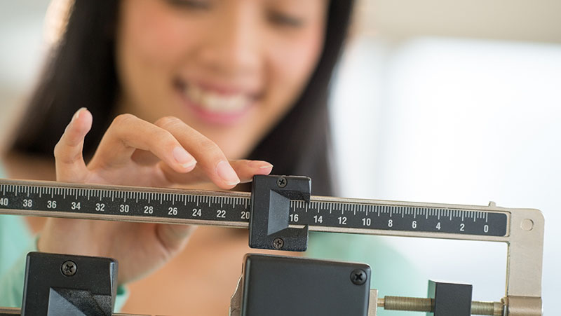 Woman checking her weight loss
