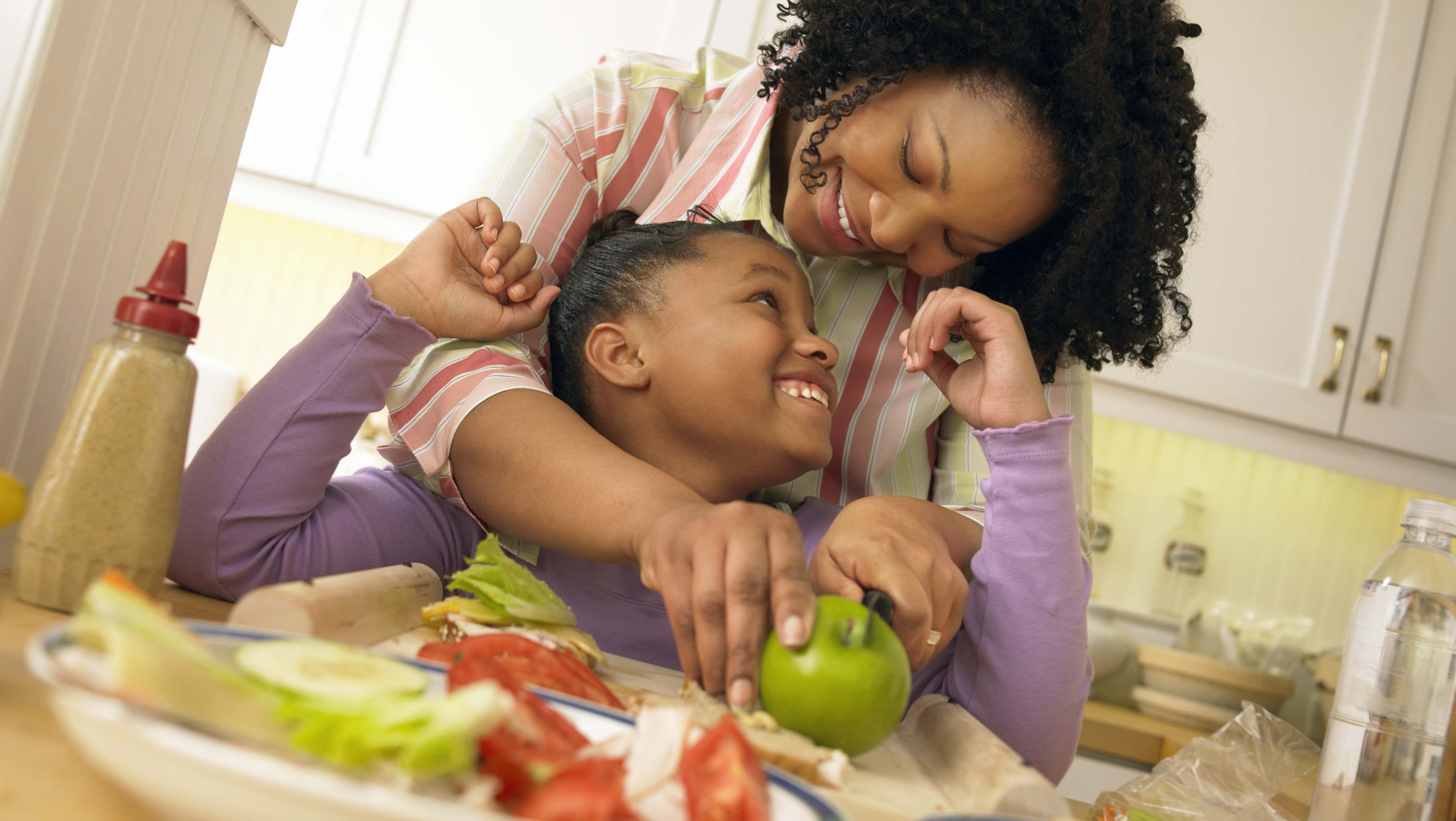 Mother and daughter prepare nutritional snack