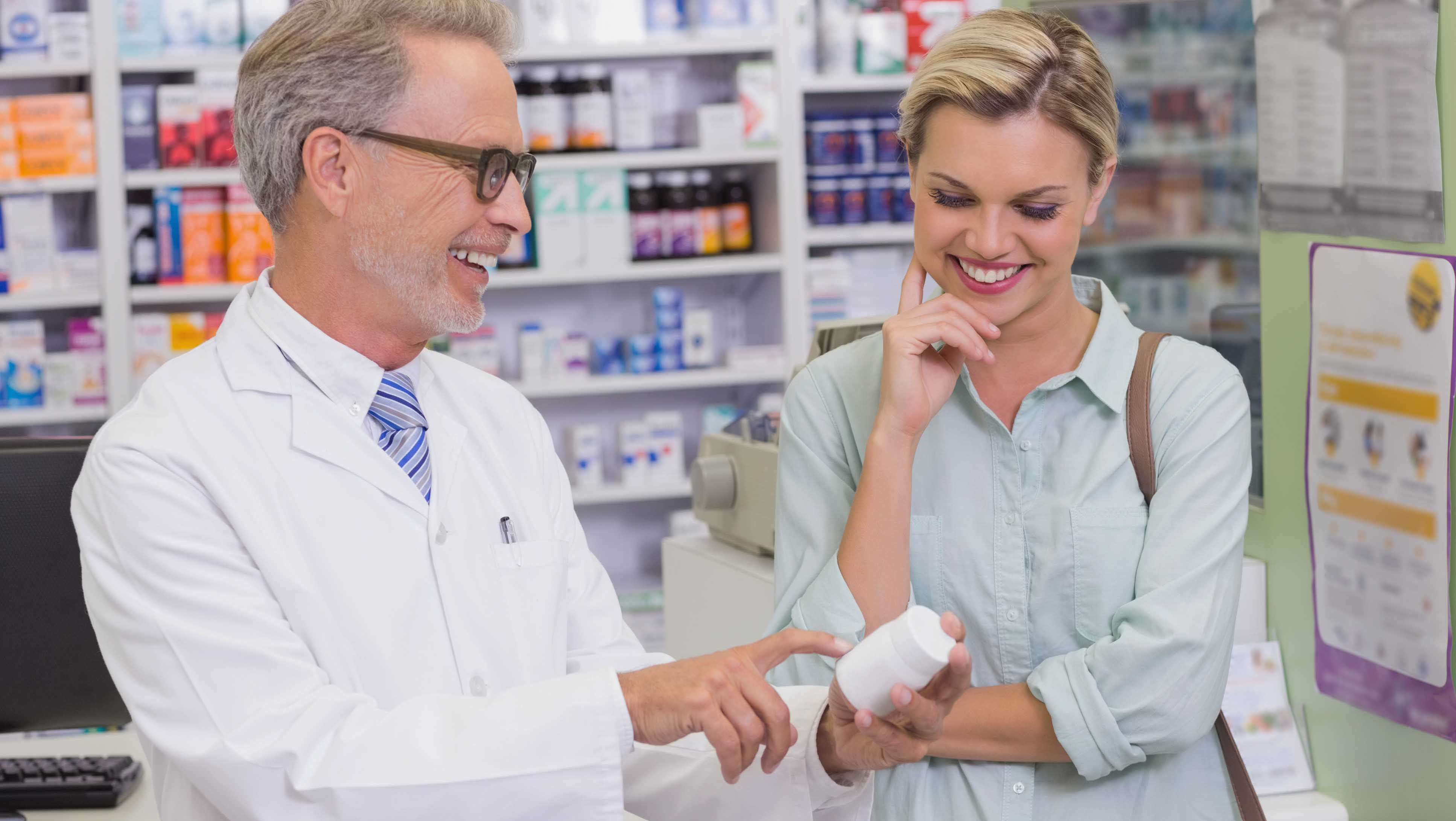 Pharmacist discusses birth control with woman
