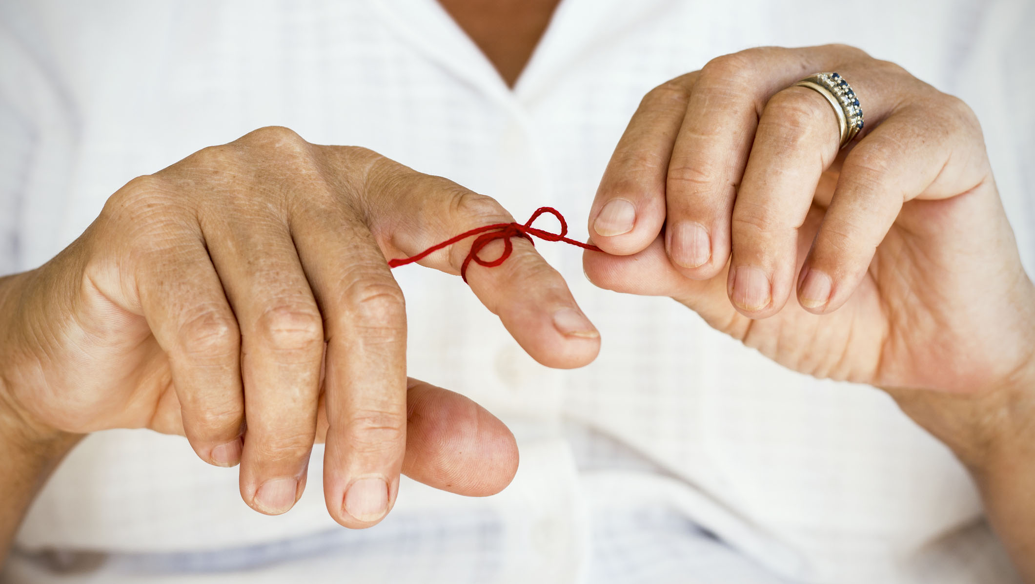 Menopausal woman with string tied on her finger