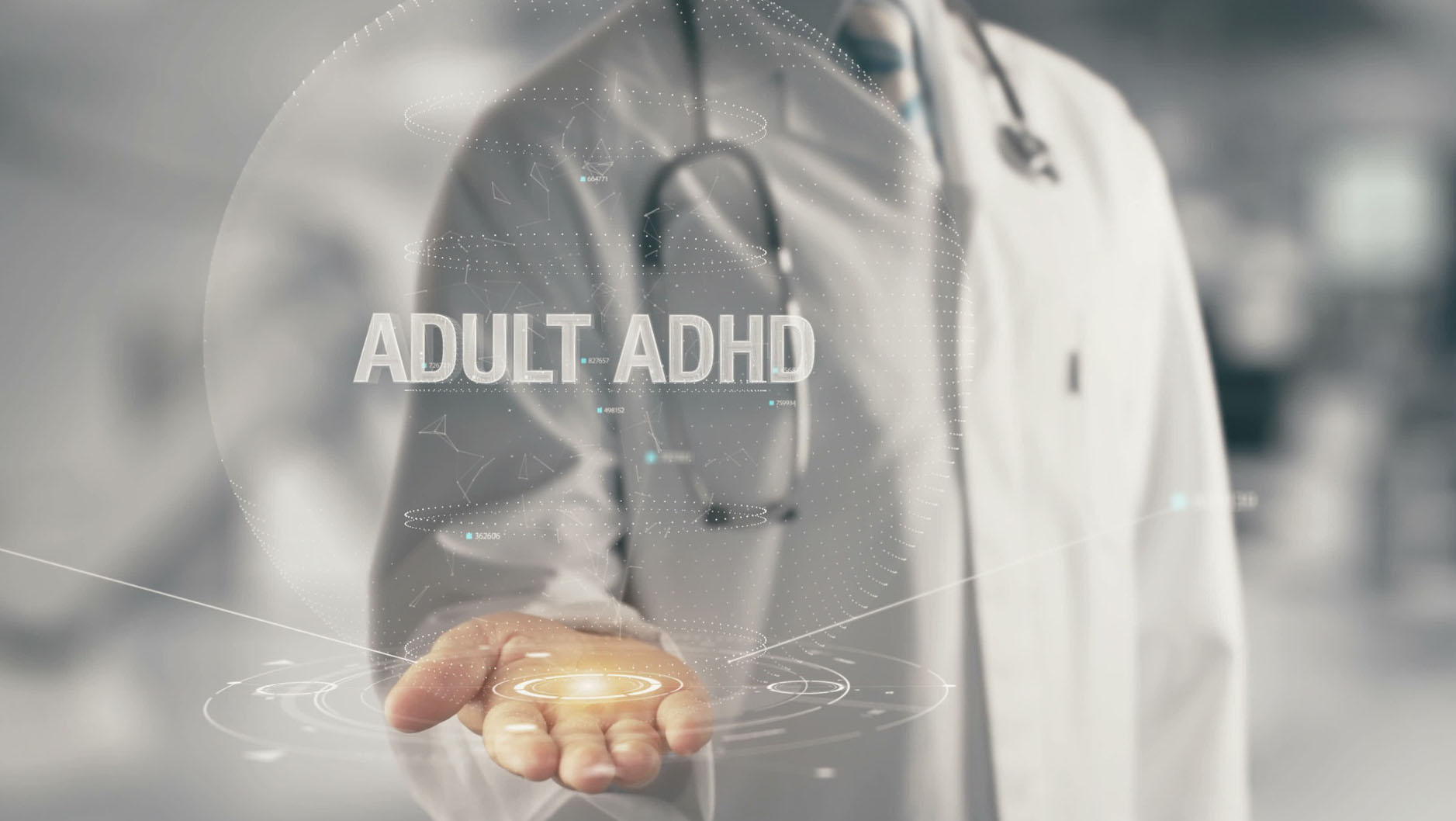 "Clinician with hand holding words ""Adult ADHD"""